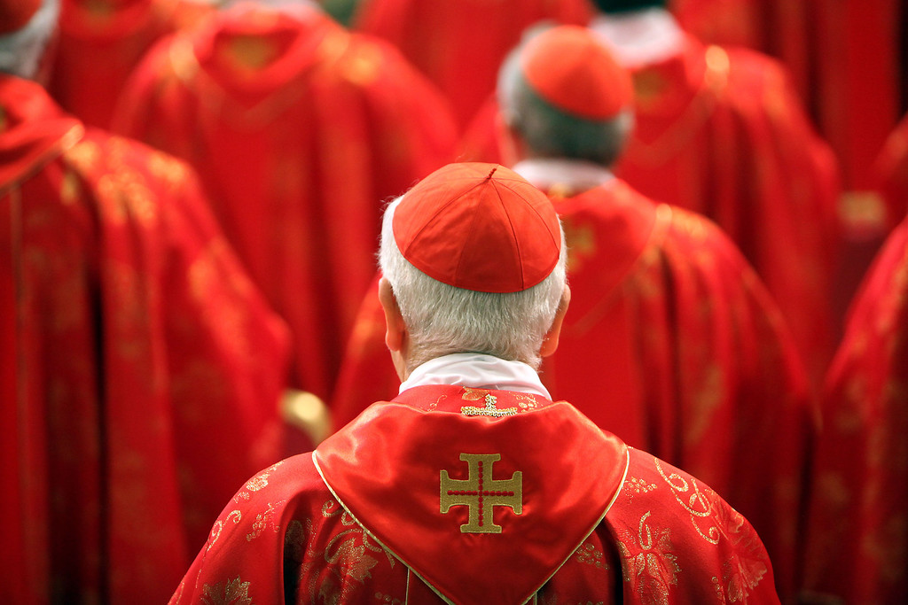 Description of . Cardinals attend the Pro Eligendo Romano Pontifice Mass at St Peter\'s Basilica, before they enter the conclave to decide who the next pope will be, on March 12, 2013 in Vatican City, Vatican.  (Photo by Franco Origlia/Getty Images)