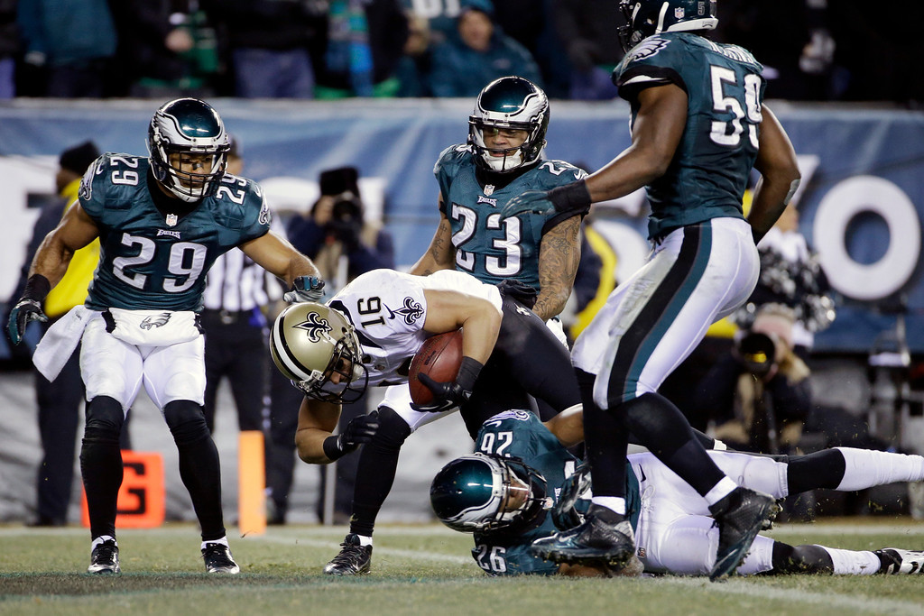 . New Orleans Saints\' Lance Moore (16) scores a touchdown past Philadelphia Eagles\' Nate Allen (29), Patrick Chung (23), Cary Williams (26) and DeMeco Ryans (59) during the second half of an NFL wild-card playoff football game, Saturday, Jan. 4, 2014, in Philadelphia. (AP Photo/Matt Rourke)