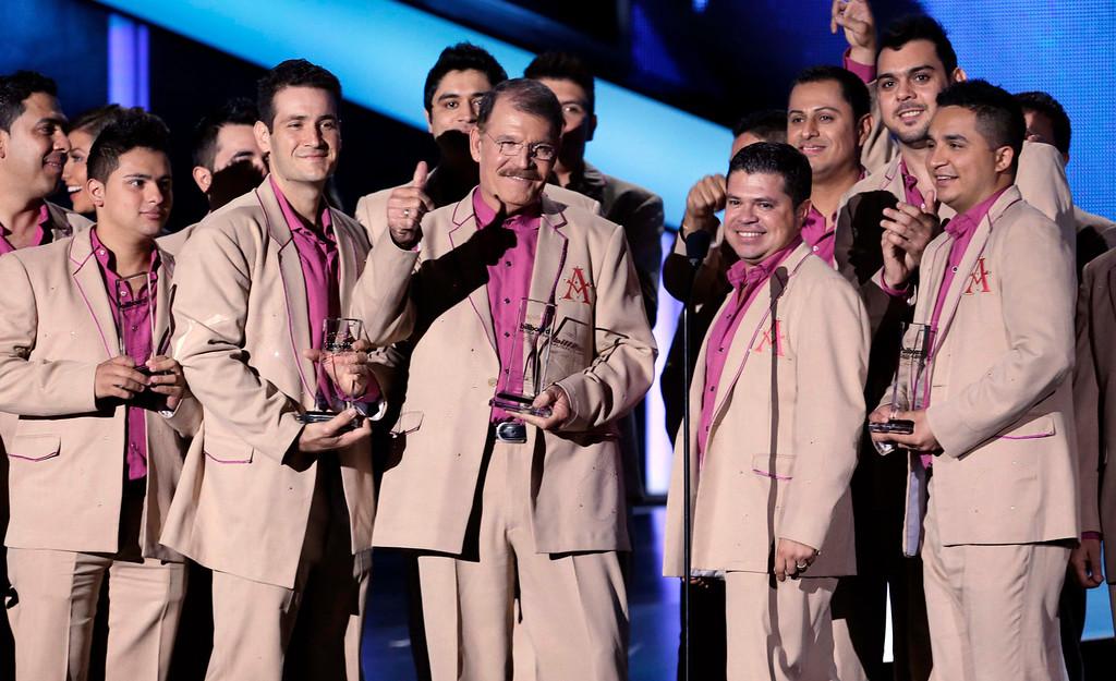 Description of . The group La Arrolladora Banda el Limon de Rene Camacho accepts the Regional Mexican Album Artist of the Year Duo or Group award at the Latin Billboard Awards in Coral Gables, Fla., Thursday April 25, 2013. (AP Photo/Alan Diaz)