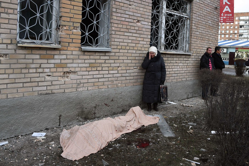 Description of . A woman cries near the body of her son, killed during a shelling at the hospital of Donetsk's Tekstilshik district, on Febuary 4, 2015. At least 12 people were killed in fighting between soldiers and pro-Russian separatists in east Ukraine, including four civilians who died when a hospital was hit in rebel stronghold Donetsk today. DOMINIQUE FAGET/AFP/Getty Images