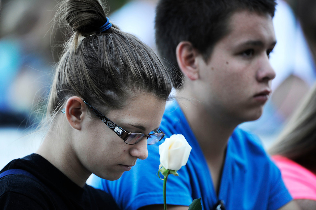 Description of . AURORA, CO - JULY 20:  Rangeview High School students, Savannah Clemente, left, 16, and best friend, Brandon Manus, 16, reflect at the 7/20 Day of Remembrance 2013 at the Aurora Municipal Center Saturday morning, July 20, 2013. Over 200 people attended the service in honor of the 12 people killed and over 60 people injured in last years Aurora theater shooting. The service included prayer, songs and speeches from local officials and the Governor of Colorado, John Hickenlooper. Savannah lost her friend Jessica Ghawi, who was killed in the shooting July 20, 2012. (Photo By Andy Cross/The Denver Post)