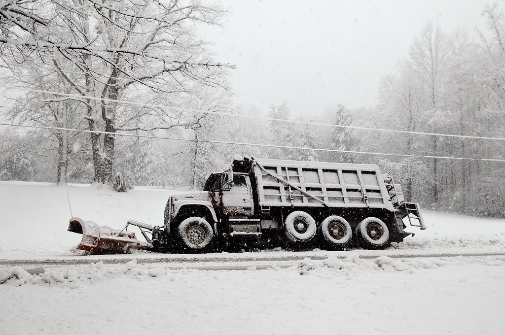 Description of . A snow plow rests in a ditch after sliding off of Brock Road in Spotsylvania,Va., Wednesday March 6, 2013.  Gov. Bob McDonnell declared a state of emergency Wednesday as up to 20 inches of snow piled up in parts of central and western Virginia. (AP Photo/The Free Lance-Star,Dave Ellis )