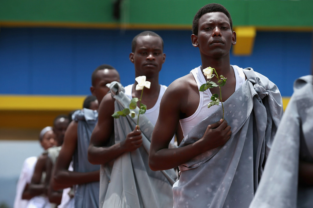 Description of . Performers enter Amahoro Stadium during the commemoration of the 20th anniversary of the 1994 genocide April 7, 2014 in Kigali, Rwanda.  (Photo by Chip Somodevilla/Getty Images)