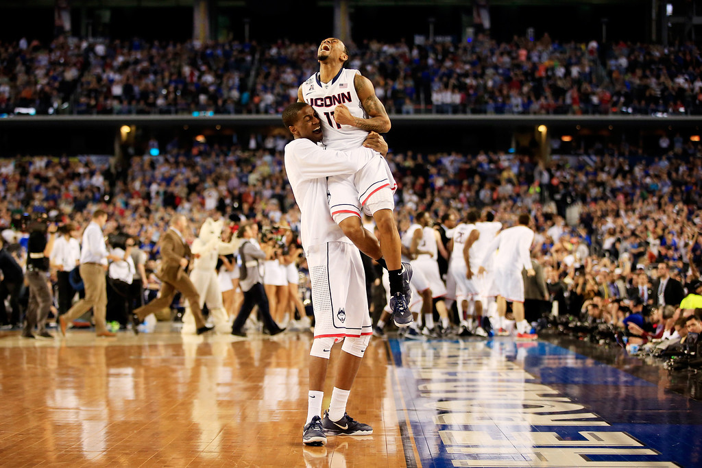 Description of . ARLINGTON, TX - APRIL 07:  Ryan Boatright #11 of the Connecticut Huskies celebrates with a teammate after defeating the Kentucky Wildcats 60-54 in the NCAA Men\'s Final Four Championship at AT&T Stadium on April 7, 2014 in Arlington, Texas.  (Photo by Jamie Squire/Getty Images)
