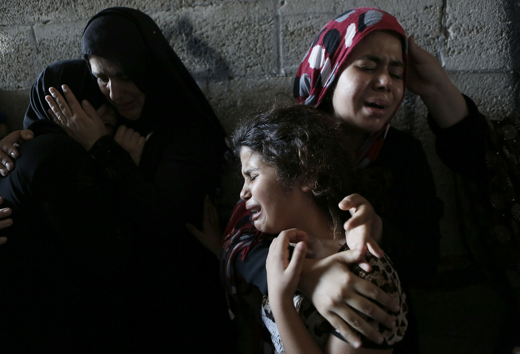Description of . The daughters (R) of Hasan Baker, 60-years-old, grieve during his funeral in Gaza City, on July 22, 2014. A series of Israeli air strikes early killed seven people in Gaza, including five members of the same family, emergency services spokesman Ashraf al-Qudra said. The deaths hike the total Palestinian toll to 583 since the Israeli military launched Operation Protective Edge on July 8 in a bid to stamp out rocket fire from Gaza. AFP PHOTO / MOHAMMED ABED/AFP/Getty Images