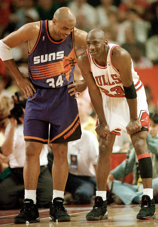 Description of . Phoenix Suns' Charles Barkley chats with Chicago Bulls' Michael Jordan during the closing moments of Game 5 in the NBA Finals at the Chicago Stadium in this June 18, 1993, file photo.  If Michael Jordan returns to the NBA, he'll almost certainly have Charles Barkley with him.  Working as a broadcaster on the NBA playoffs for Turner Sports, Barkley sounded excited Tuesday,  April 24, 2001 by the prospect of a joint comeback with Jordan.     Barkley said he would return to the court if he could getback in shape _ and had some company.(AP Photo/John Swart, File)