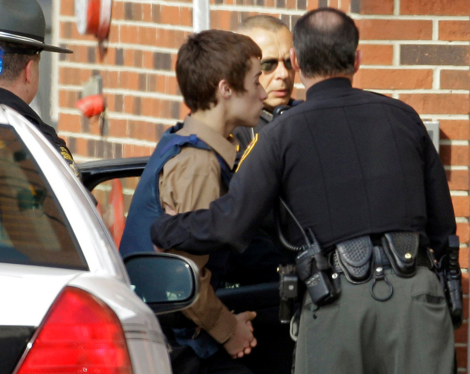 Description of . T.J. Lane, a suspect in Monday's shooting of five students at Chardon High School is taken into juvenile court by Geauga County deputies in Chardon, Ohio on Tuesday, Feb. 28, 2012. Three of the five students wounded in the attacks have since died. (AP Photo/Mark Duncan)