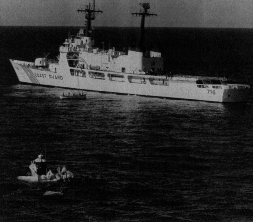 . A piece of debris from the Space Shuttle Challenger, lower left, is towed to the Coast Guard cutter Dallas off the coast of Florida.   Denver Post Library Archive