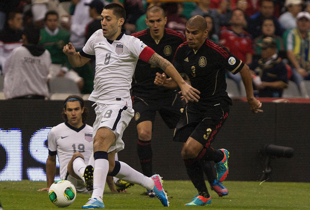 Description of . Clinton Dempsey  #8 of the United States drives with the ball during a match between Mexico and USA as part of FIFA 2014 World Cup Qualifier at The Azteca stadium on March 26, 2013 in Mexico City, Mexico. (Photo by Miguel Tovar/Getty Images)