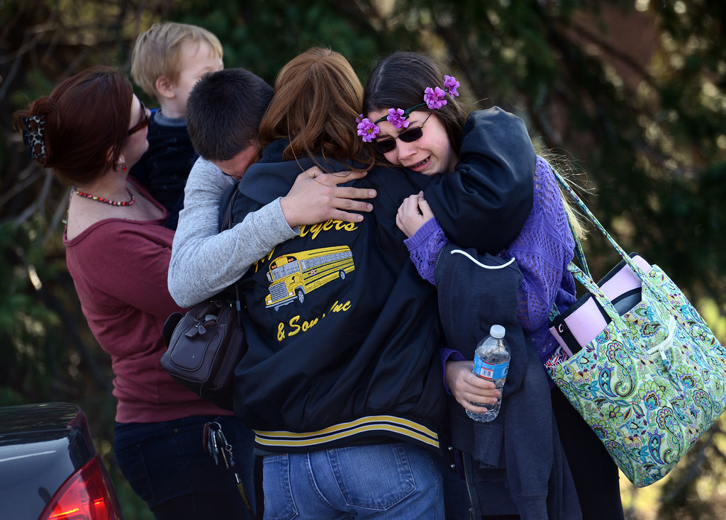 Description of . Parents and students embrace along School Road near Franklin Regional High School after more than a dozen students were stabbed by a knife wielding suspect at the school on Wednesday, April 9, 2014, in Murrysville, Pa., near Pittsburgh. The suspect, a male student, was taken into custody and is being questioned. (AP Photo/Tribune Review, Sean Stipp)