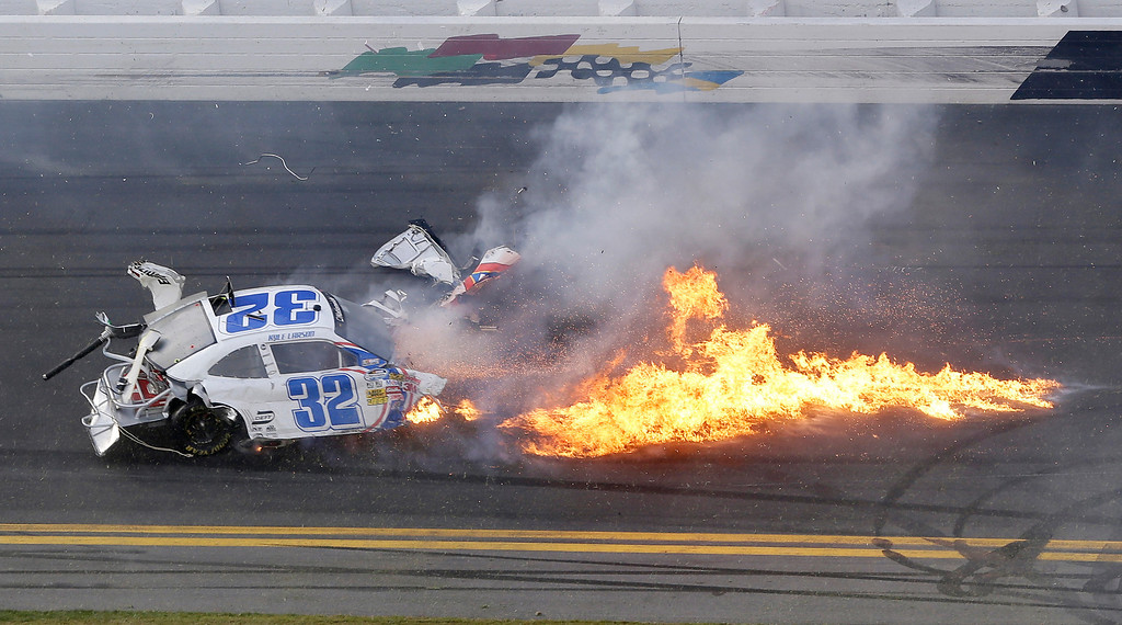 Description of . Kyle Larson's car comes apart after a crash at the conclusion of the NASCAR Nationwide Series auto race Saturday, Feb. 23, 2013, at Daytona International Speedway in Daytona Beach, Fla. (AP Photo/Chris O'Meara)
