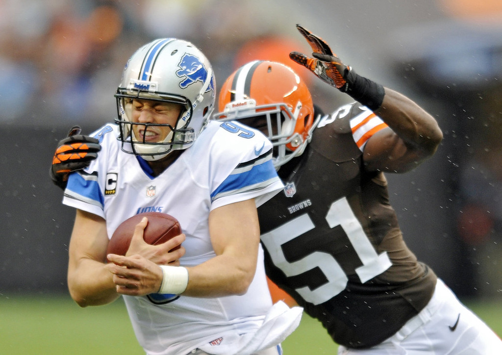 Description of . Detroit Lions quarterback Matthew Stafford is chased by Cleveland Browns linebacker Barkevious Mingo in the second quarter of an NFL football game Sunday, Oct. 13, 2013 in Cleveland. (AP Photo/David Richard)