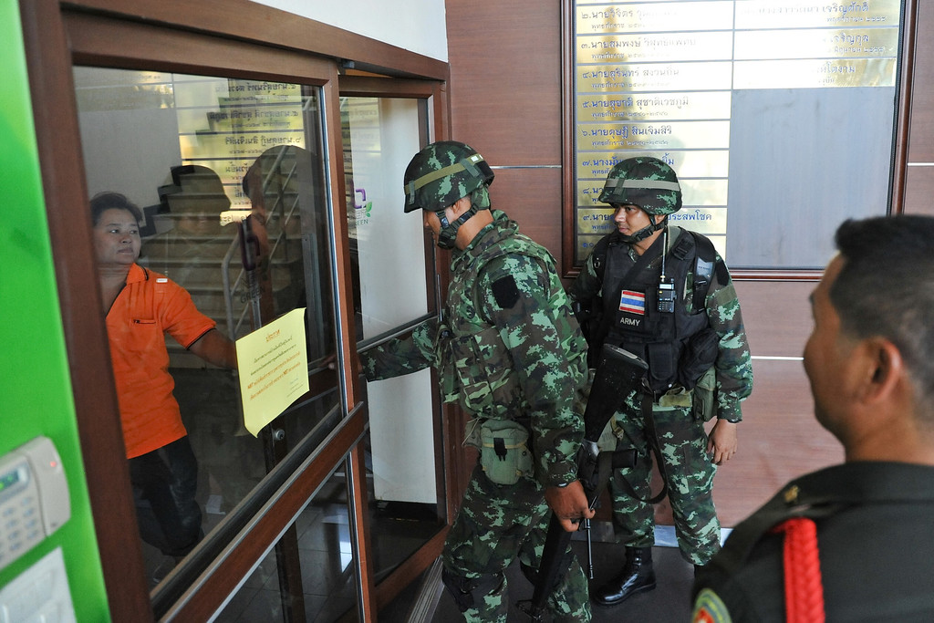 Description of . Thai army soldiers enter the National Broadcasting Services of Thailand after martial law was declared on May 20, 2014 in Bangkok, Thailand.  (Photo by Rufus Cox/Getty Images)