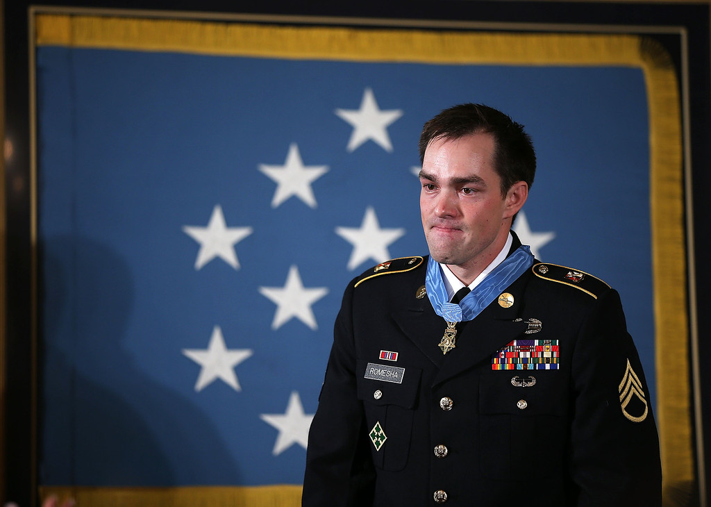 Description of . Clinton Romesha (L), a former active duty Army Staff Sergeant, stands after he was presented with the Medal of Honor for conspicuous gallantry by U.S. President Barack Obama at the White House February 11, 2013 in Washington, DC. (Photo by Alex Wong/Getty Images)
