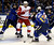 St. Louis Blues' Vladimir Sobotka, of the Czech Republic, controls the puck as teammate Roman Polak, left, of the Czech Republic, and Detroit Red Wings' Valtteri Filppula, center, of Finland, look on during the first period of an NHL hockey game Saturday, Jan. 19, 2013, in St. Louis. (AP Photo/Jeff Roberson)