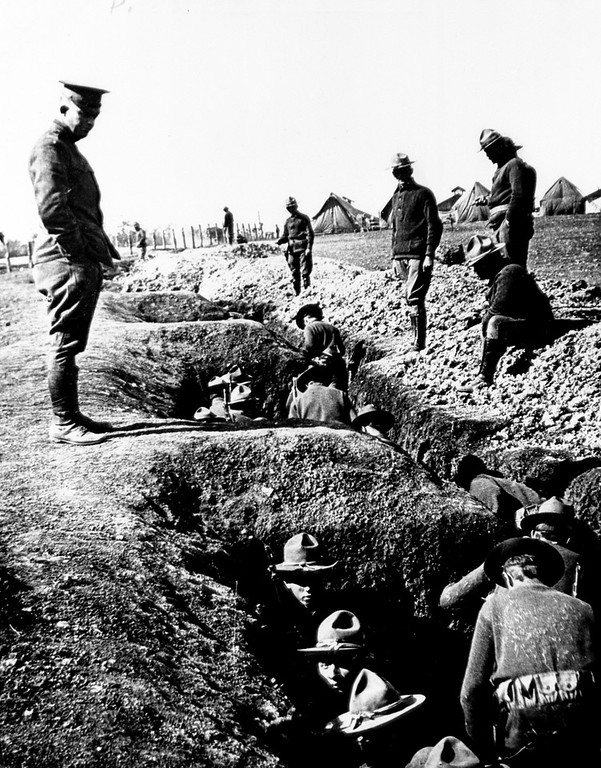 Description of . U.S. Lt. Dwight D. Eisenhower watches Illinois troops dig trenches during training at San Antonio, Ft. Houston, Texas, in 1916.  (AP Photo/The D.D. Eisenhower Library)