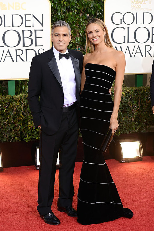 Description of . Actor George Clooney (L) and actress Stacy Keibler arrive at the 70th Annual Golden Globe Awards held at The Beverly Hilton Hotel on January 13, 2013 in Beverly Hills, California.  (Photo by Jason Merritt/Getty Images)