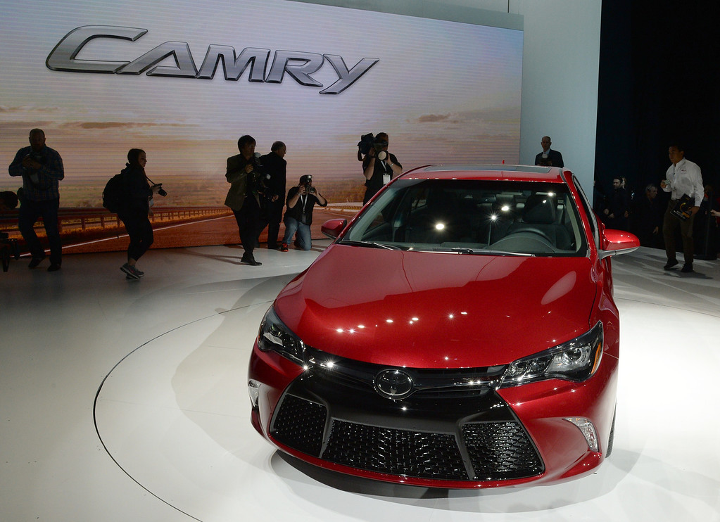 Description of . Toyota unveils a 2015 Toyota Camry on April 16, 2014 during the New York International Auto Show at the Jacob Javits Center in New York. AFP PHOTO/Don EMMERT/AFP/Getty Images