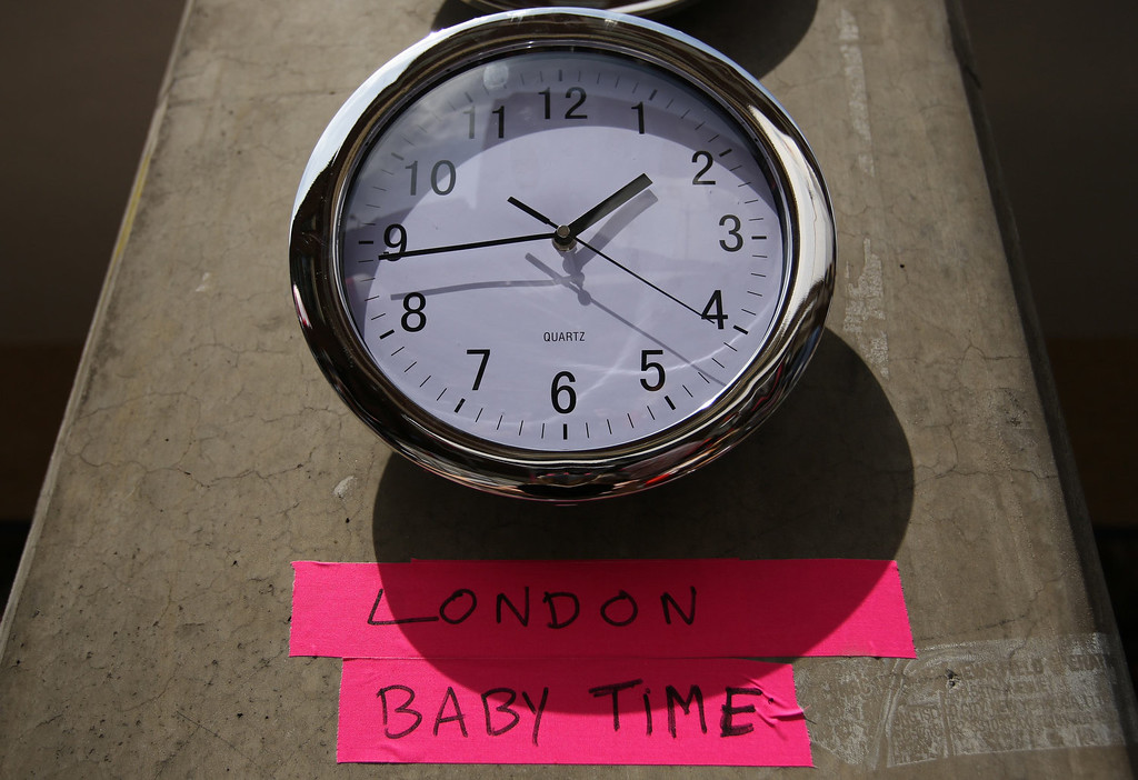 Description of . A clock in the press pen shows the time outside the Lindo Wing of St Mary\'s Hospital, where Britain\'s Catherine, Duchess of Cambridge is due to give birth, in London July 15, 2013. The first child of Prince William and his wife Kate is due in mid-July, with the couple saying they have no idea of the sex of the baby, who will be third in line to the British throne.  REUTERS/Olivia Harris