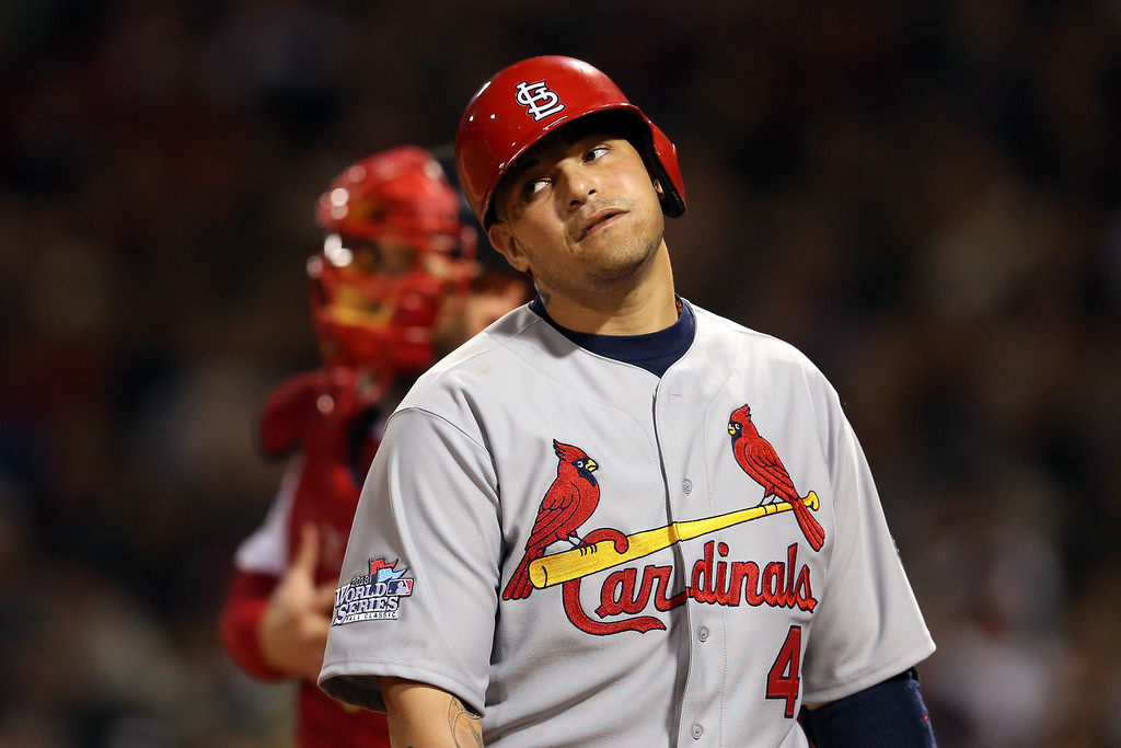 Description of . Yadier Molina #4 of the St. Louis Cardinals reacts after striking out in the second inning against the Boston Red Sox during Game One of the 2013 World Series at Fenway Park on October 23, 2013 in Boston, Massachusetts.  (Photo by Rob Carr/Getty Images)