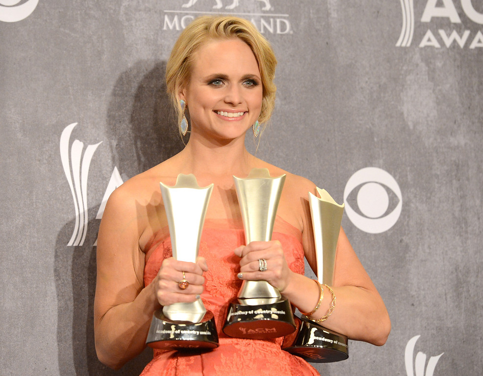 Description of . Singer Miranda Lambert poses in the press room with the Best Female Vocalist award during the 49th Annual Academy Of Country Music Awards at the MGM Grand Garden Arena on April 6, 2014 in Las Vegas, Nevada.  (Photo by Jason Merritt/Getty Images)