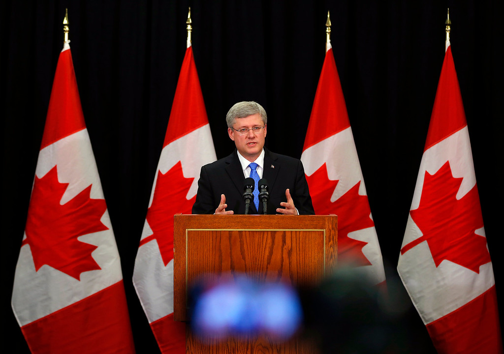 Description of . Canadian Prime Minister Setphen Harper answers questions on the train explosion in Quebec in Calgary, Alberta, July 6, 2013. REUTERS/Todd Korol