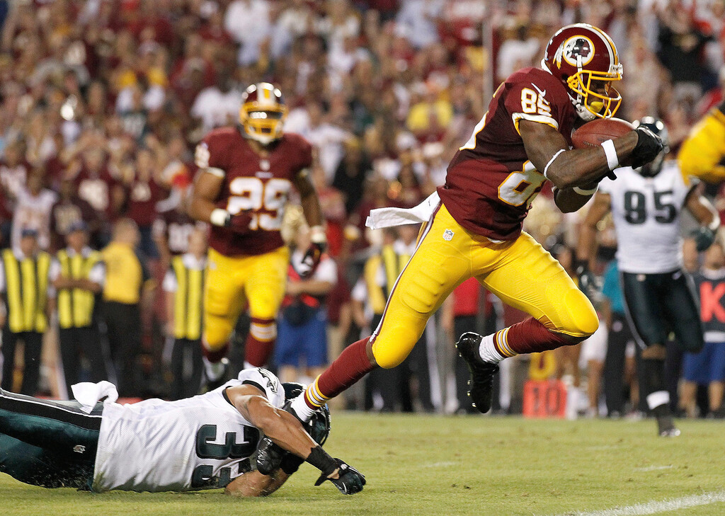 Description of . Washington Redskins wide receiver Leonard Hankerson, right, breaks a tackle by Philadelphia Eagles cornerback Jordan Poyer as he heads toward the end zone for a touchdown during the second half of an NFL football game in Landover, Md., Monday, Sept. 9, 2013. (AP Photo/Alex Brandon)