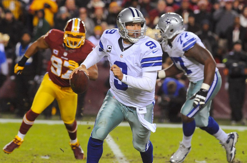 . Dallas Cowboys quarterback Tony Romo (9) scrambles during the first half of an NFL football game against the Washington Redskins on Sunday, Dec. 30, 2012, in Landover, Md. (AP Photo/Richard Lipski)