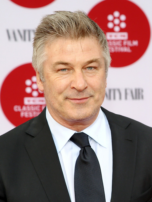 Description of . In this April 10, 2014 file photo, Alec Baldwin arrives 2014 TCM Classic Film Festival's Opening Night Gala at the TCL Chinese Theatre in Los Angeles. Canadian actress Genevieve Sabourin was convicted in November 2013 of stalking Baldwin with emails, phone calls, and unsolicited visits to his Manhattan apartment. Sabourian and Baldwin met in 2000 on a movie set and had dinner a decade later, and the actress said Baldwin made promises of a life together. The judge who sentenced her said no matter what happened between the two, Sabourin had no right to pursue contact she knew to be unwanted and amounted to a