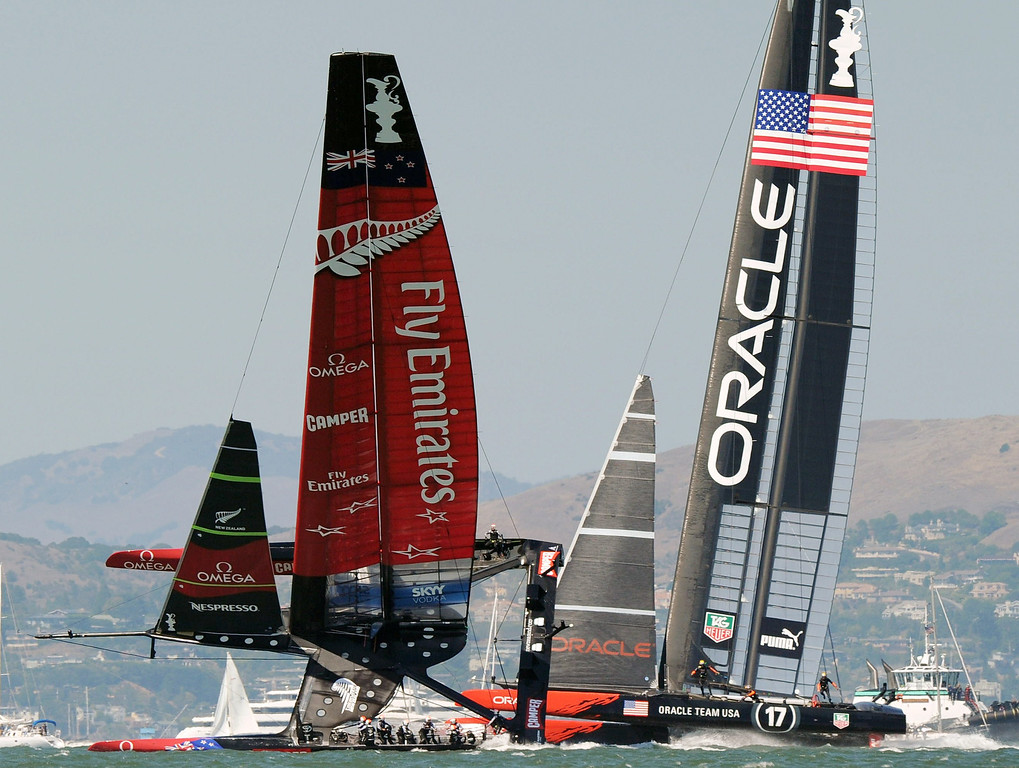 Description of . Emirates Team New Zealand (L) competes against Oracle Team USA during the 34th America's Cup on September 14, 2013 in San Francisco.   DON EMMERT/AFP/Getty Images