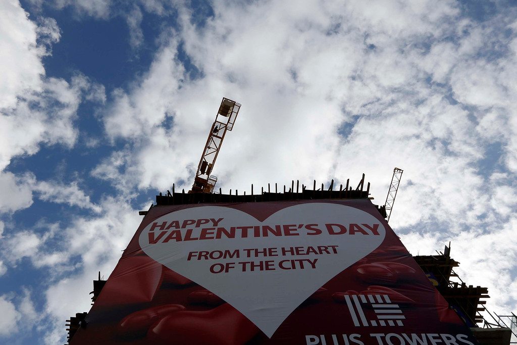Description of . A huge banner is seen on a construction building in celebration of Valentine's Day in downtown Beirut, February 14, 2013 . REUTERS/Jamal Saidi