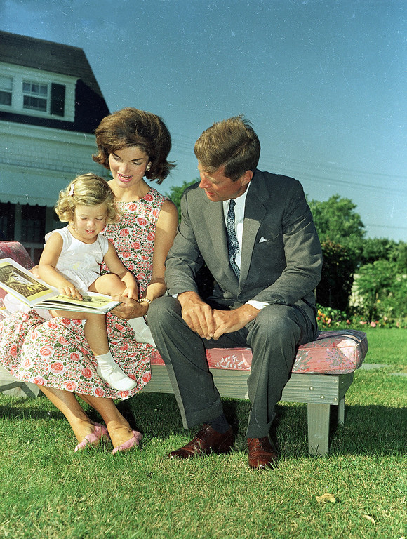 Description of . President Kennedy sits with Jacqueline and   Caroline  at Hyannis, Mass., on July 25, 1960.  Associated Press file