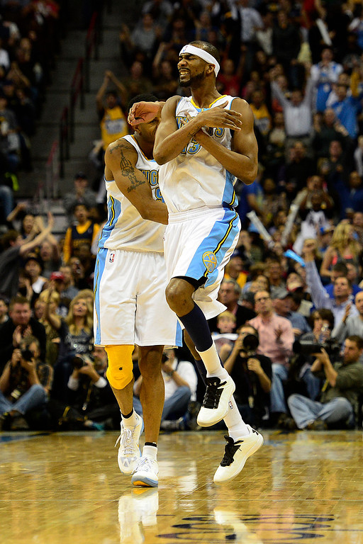 Description of . Denver Nuggets small forward Corey Brewer (13) celebrates a three pointer against the Los Angeles Lakers during the second half of the Nuggets' 126-114 win at the Pepsi Center on Wednesday, December 26, 2012. AAron Ontiveroz, The Denver Post