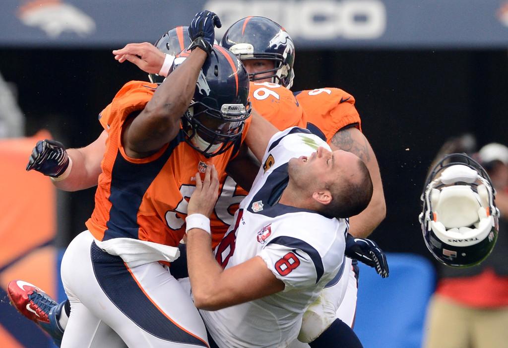 Description of . Denver Broncos middle linebacker Joe Mays knocks Houston Texans\' Quarterback Matt Schaub\'s helmet off during the third quarter of play at Sports Authority Field at Mile High in Denver, CO on Sunday, September 23, 2012.  Joe Amon/The Denver Post