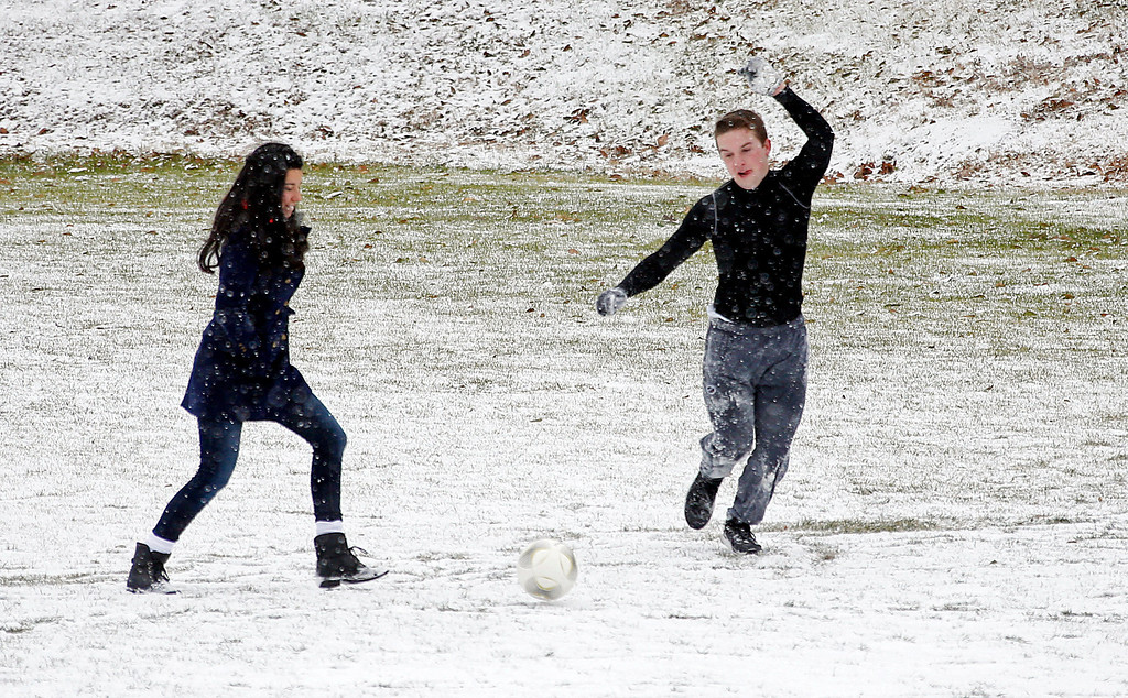 Description of . Belhaven University students Melissa Rey, left, and James Lewellan take advantage of the snow to play soccer on campus Tuesday, Jan. 28, 2014, on the Jackson, Miss., campus. An arctic blast spread across Mississippi with below freezing temperatures and treacherous driving conditions. (AP Photo/Rogelio V. Solis)
