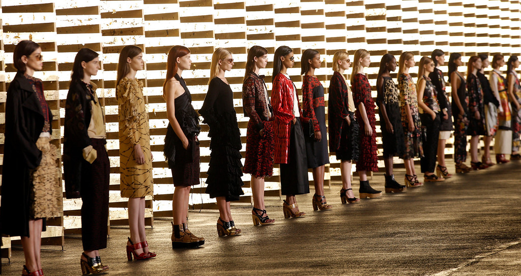 Description of . Models wear creations for Belgian fashion house Dries van Noten's ready-to-wear Spring/Summer 2014 fashion collection, presented in Paris, Wednesday, Sept.25, 2013. (AP Photo/Christophe Ena)