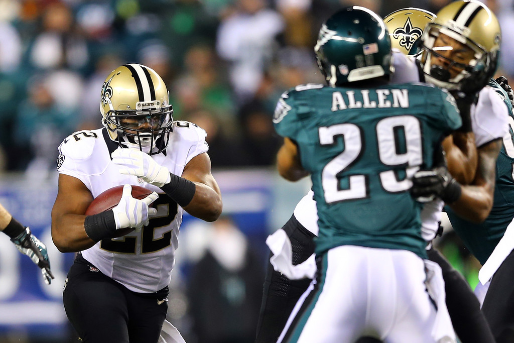 Description of . PHILADELPHIA, PA - JANUARY 04:  Mark Ingram #22 of the New Orleans Saints runs the ball in the first quarter against the Philadelphia Eagles during their NFC Wild Card Playoff game at Lincoln Financial Field on January 4, 2014 in Philadelphia, Pennsylvania.  (Photo by Elsa/Getty Images)