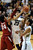 Sabatino Chen of Colorado goes to the basket on Gabriel Harris  of Stanford during the second half of the January 24th, 2013 game in Boulder.