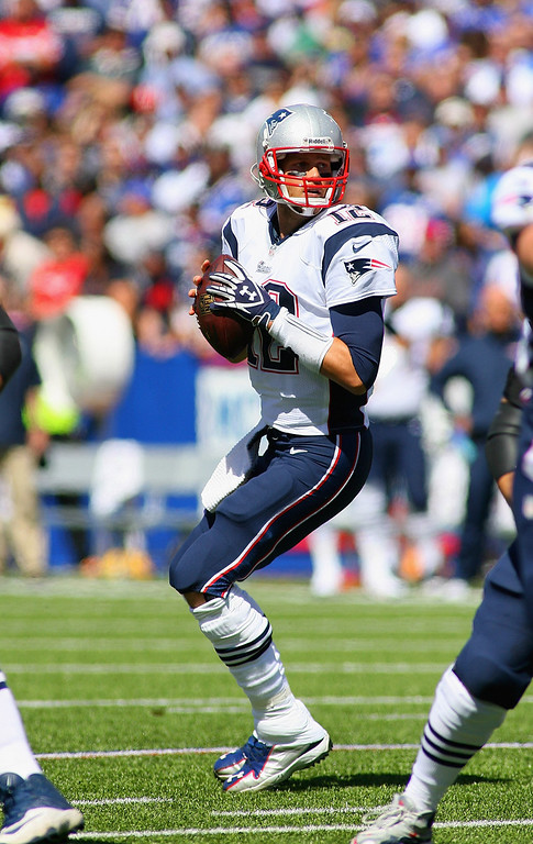 Description of . Tom Brady #12 of the New England Patriots looks turnover pass against the New England Patriots at Ralph Wilson Stadium on September 8, 2013 in Orchard Park, New York.  (Photo by Rick Stewart/Getty Images)