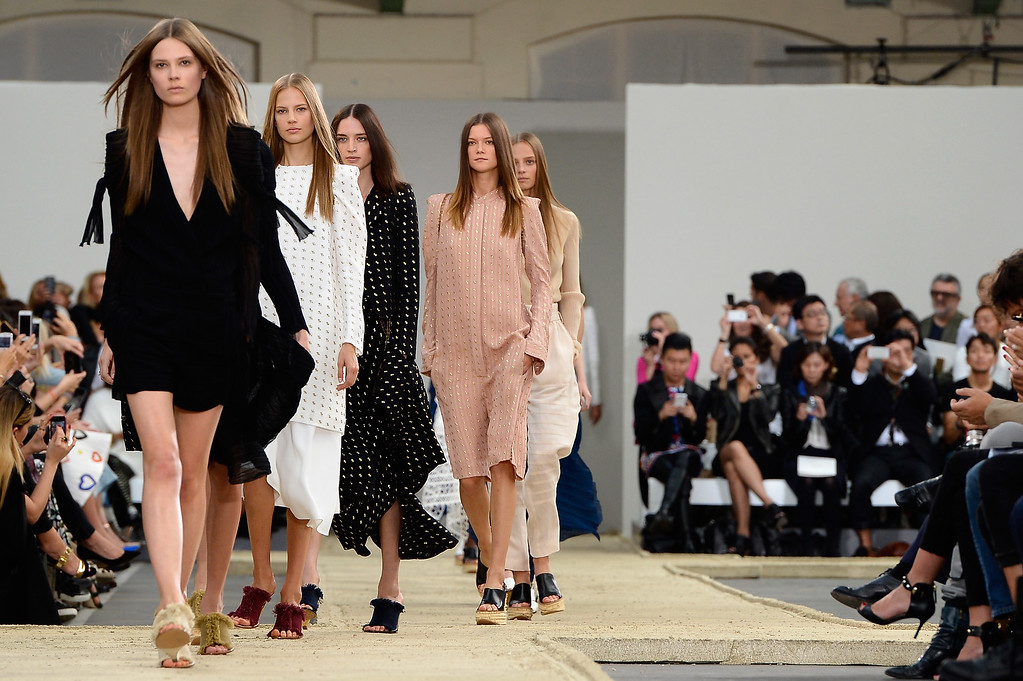 Description of . PARIS, FRANCE - SEPTEMBER 29:  Modesl walk the runway during the Chloe show finale as part of the Paris Fashion Week Womenswear Spring/Summer 2014 at Lycee Carnot on September 29, 2013 in Paris, France.  (Photo by Pascal Le Segretain/Getty Images)