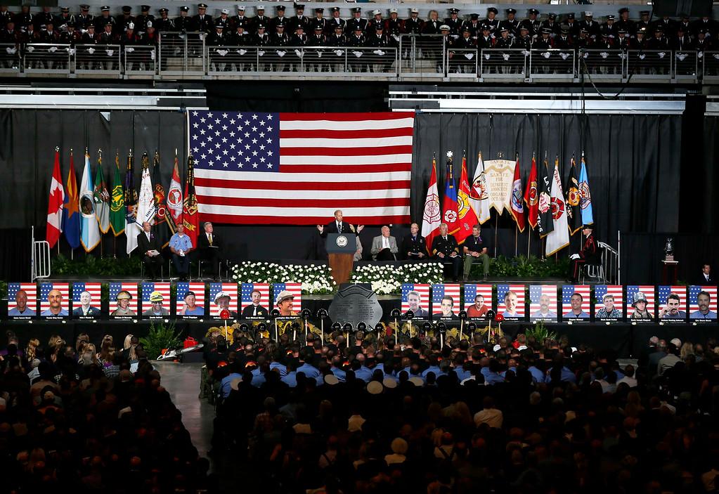 Description of . U.S. Vice President Joe Biden speaks at a memorial service for the fallen members of the Granite Mountain Hotshots, in Prescott Valley, Arizona July 9, 2013.  REUTERS/Lucy Nicholson