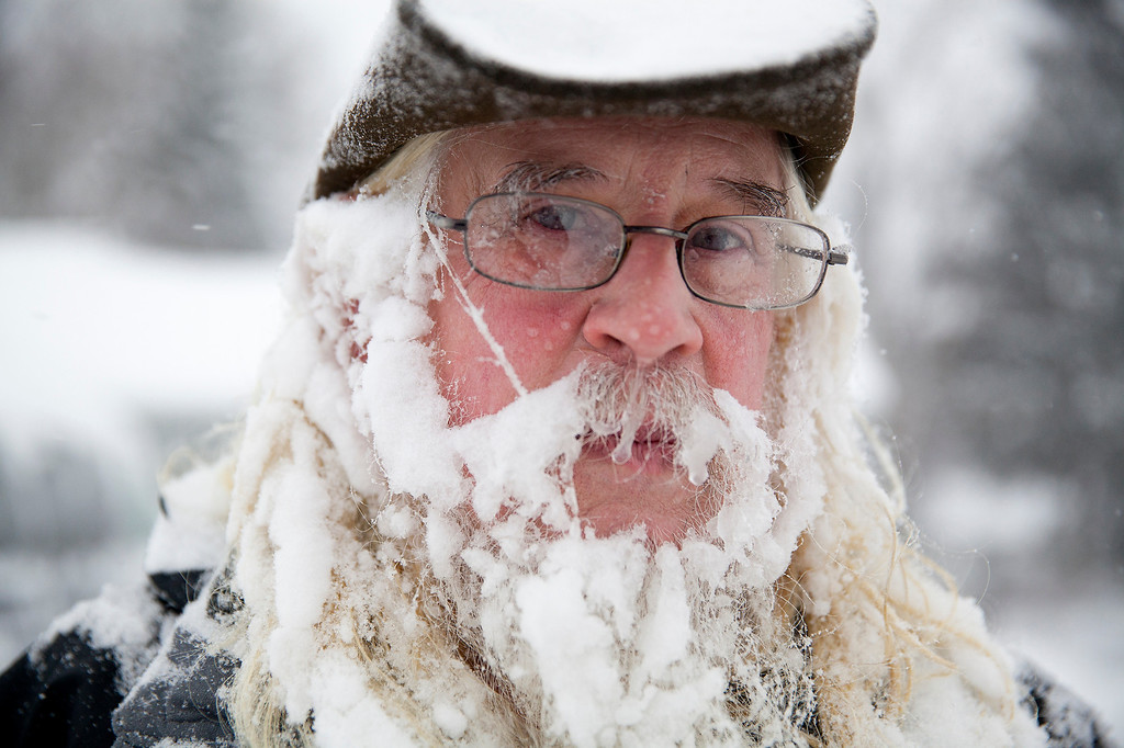 Description of . Lee Tuttle, 66, takes a break from blowing snow off of his driveway to pose for a portrait on Sunday, January 5, 2014 at his home on Miller Road in Flint, Mich. He said he hadn't really noticed the icicles forming in his beard.     (AP Photo/The Flint Journal, Michelle Tessier)