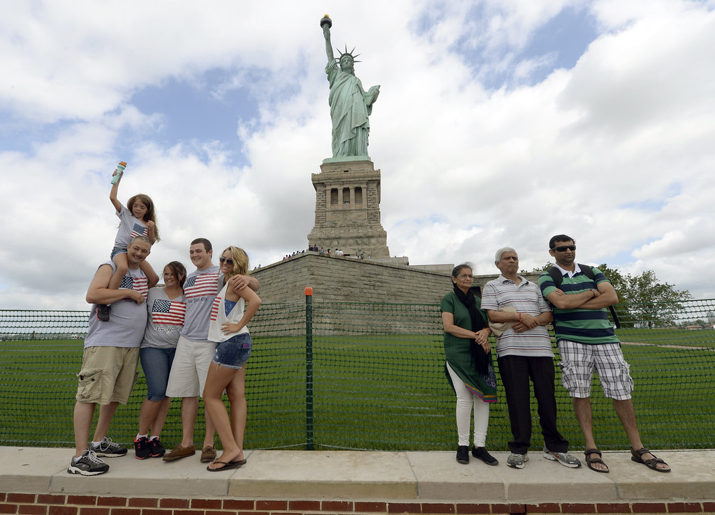 Description of . Visitors take photos at the  Statue of Liberty, as Liberty Island opens to the public on July 4, 2013 for the first time since Superstorm Sandy slammed into the New York area. The Statue of Liberty, one of America's most recognizable symbols, reopens just in time for the July 4 national holiday, after being repaired from damage inflicted last year by Hurricane Sandy. TIMOTHY CLARY/AFP/Getty Images