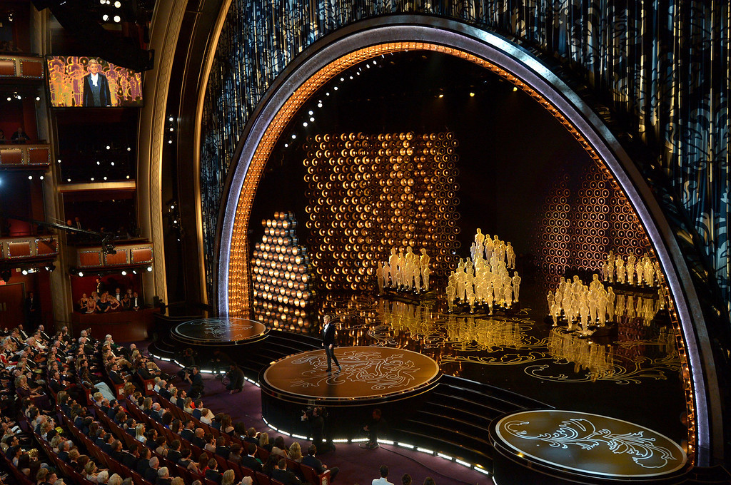 Description of . Ellen DeGeneres hosts the Oscars at the Dolby Theatre on Sunday, March 2, 2014, in Los Angeles.  (Photo by John Shearer/Invision/AP)
