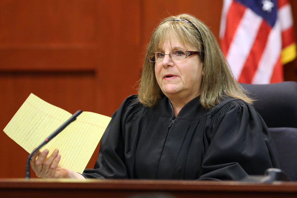Description of . SANFORD, FL - JULY 13:  Judge Debra Nelson addresses attorneys after informing them that the jury had a question on instructions for a charge of manslaughter, on the 25th day of George Zimmerman's trial at the Seminole County Criminal Justice Center July 13, 2013 in Sanford, Florida. Zimmerman is charged with second-degree murder in the 2012 shooting death of Trayvon Martin.  (Photo by Joe Burbank-Pool/Getty Images)