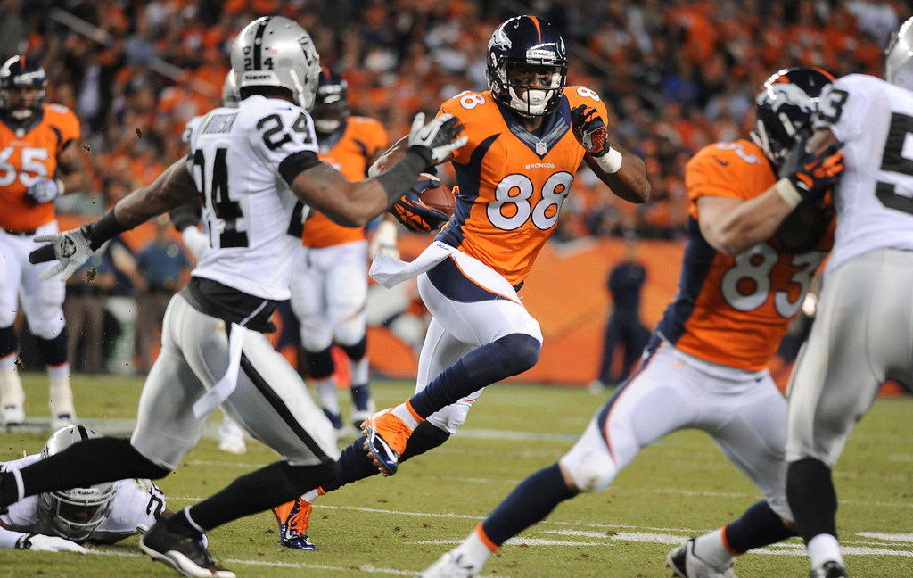 Description of . Denver Broncos wide receiver Demaryius Thomas gets loose for a big gain in the first quarter. The Denver Broncos took on the Oakland Raiders at Sports Authority Field at Mile High in Denver on September 23, 2013. (Photo by Steve Nehf/The Denver Post)