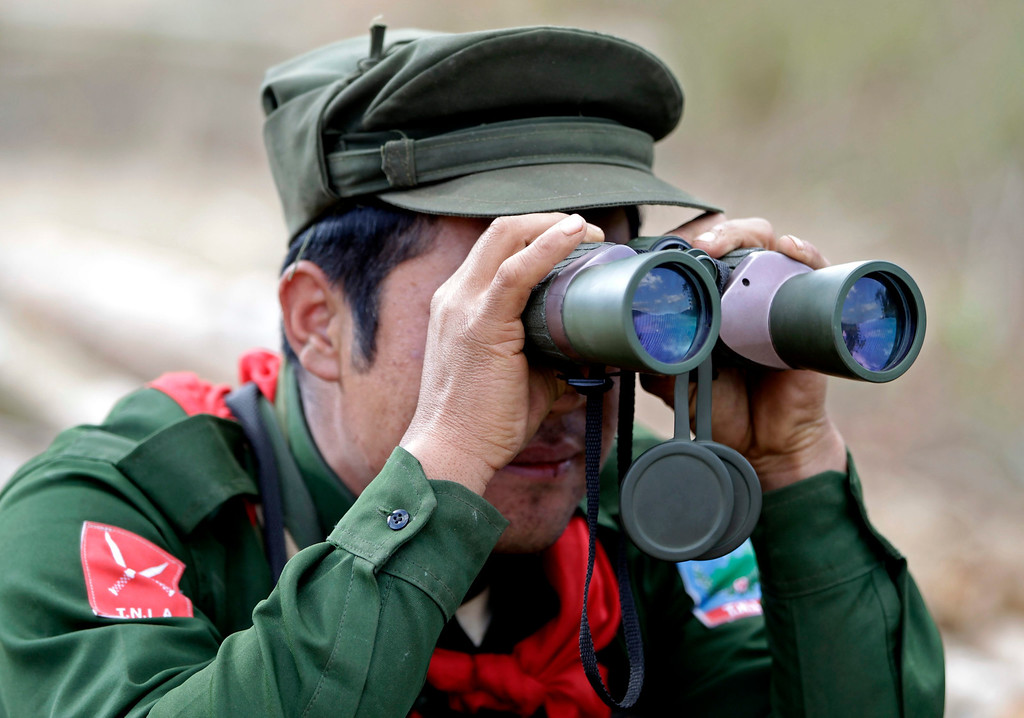 Description of . A soldier of the Ta-ang National Liberation Army (TNLA), one of the ethnic rebel groups, searching for poppy fields in Loi Mel Main village, Man Tone Township, Northern Shan State, Myanmar.  EPA/NYEIN CHAN NAING