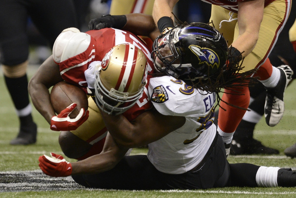 Description of . Dannell Ellerbe  (R) of the Baltimore Ravens brings down Frank Gore (L) of the San Francisco 49ers during Super Bowl XLVII at the Mercedes-Benz Superdome on February 3, 2013 in New Orleans, Louisiana.     TIMOTHY A. CLARY/AFP/Getty Images