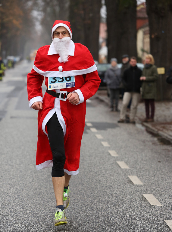 Description of . A participant warms up to compete in the 5th annual Michendorf Santa Run (Michendorfer Nikolauslauf) on December 8, 2013 in Michendorf, Germany. Over 900 people took part in this year's races, which included one for children and one for adults.  (Photo by Adam Berry/Getty Images)
