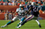 Running back Daniel Thomas #33 of the Miami Dolphins rushes against cornerback Kyle Arrington #24 of the New England Patriots at Sun Life Stadium on December 2, 2012 in Miami Gardens, Florida.  (Photo by Chris Trotman/Getty Images)
